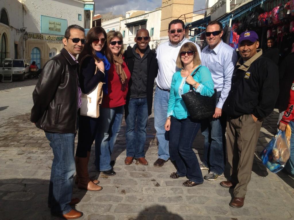Colmon Eldrige, fourth from the left, explores a Tunisian market