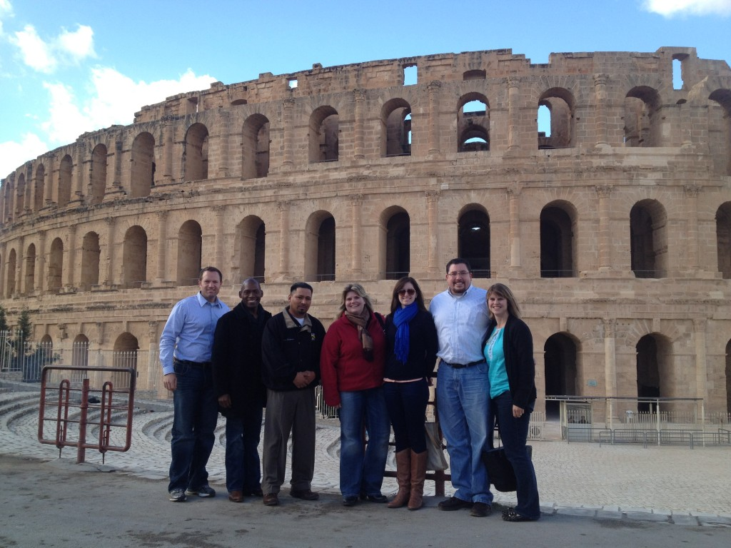 Holly Chisa, on the far right, visits the Roman amphitheater of Thysdrus